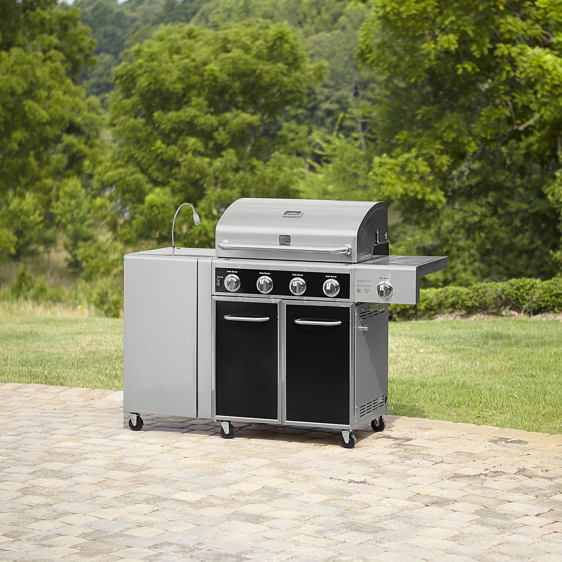 Kenmore 4 Burner Gas Grill with folding side table, Lit knobs, and folding table light