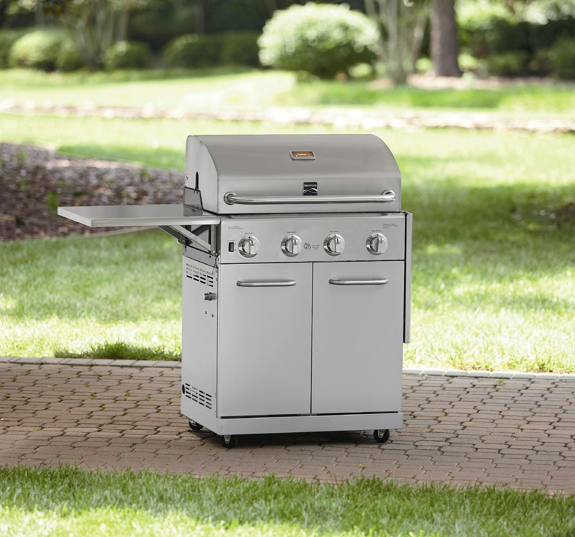 Kenmore Stainless Steel 4 Burner Gas Grill With Folding Side Shelves and lit knobs
